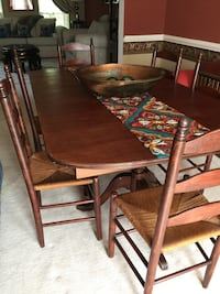 Antique dining table with 6 chairs 6ft long by 42 w - 30 H. Has two small cracks due to the years but still very solid table. Gainesville, 20155