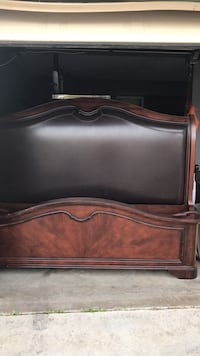 brown wooden bed headboard and footboard Perris