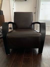 Modern brown leather chair with wood arms. Fort Lauderdale, 33308
