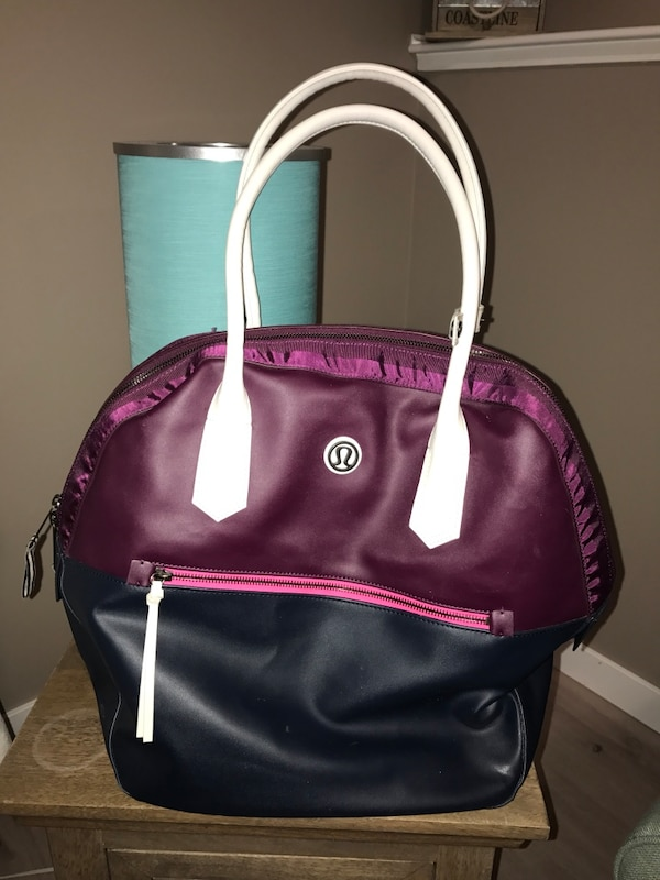 df3823fb8de1 Used purple and black Lululemon leather bag for sale in Calgary - letgo