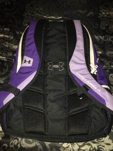 purple, white, and black Under Armour backpack