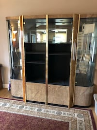 Brown wooden framed glass display cabinet I have added the second piece still $100 189 mi