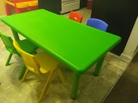 green and yellow wooden table with chairs ATLANTA