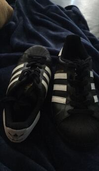 pair of black-and-white Adidas sneakers Houston, 77063