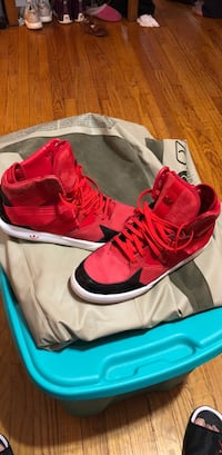 Pair of red Adidas basketball shoes Chicago, 60656