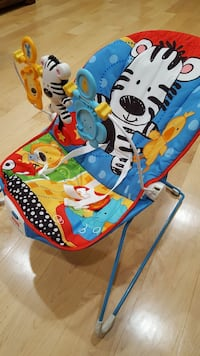 blue and red animal-themed bouncer chair
