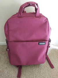 pink and black leather backpack