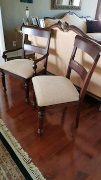 8 solid wood chairs, plus 2 captain chairs