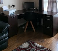 ONLY DESK INCLUDED Solid wood Dark Walnut corner desk (no hutch) with one swing door cupboard (shelves) and 3 pull drawers (2 lock keys included)  Edmonton, T5Y 0L8