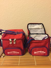 Two red-and-blue lunch bags