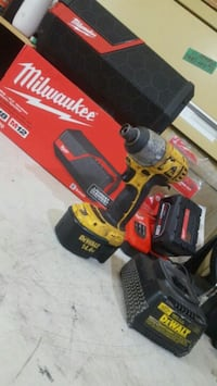 red and black Milwaukee cordless drill Spanaway, 98387