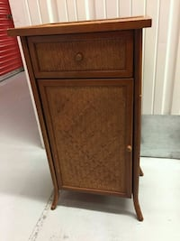 brown woven bedside table