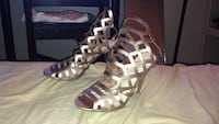 pair of brown leather open-toe gladiator sandals Winnipeg, R2M 2K7