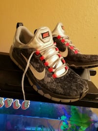 pair of black-and-gray Nike running shoes St. Louis, 63146