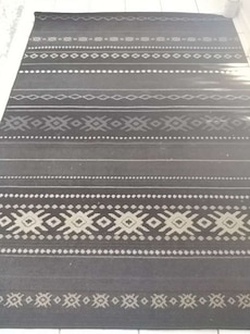 gray and black area rug