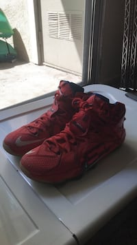 pair of red Nike basketball shoes Modesto, 95355