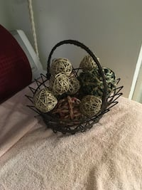 Decorative balls in iron basket