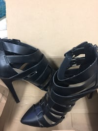 pair of black leather peep toe platform stilettos Middlesex Centre