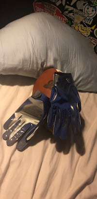 Blue and black Under Armour Football gloves North Potomac, 20878