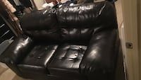 black leather 2-seat sofa perfect condition