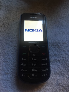 black Nokia Phone With USB Cable Only.