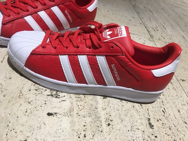 Red-and-white adidas superstar low-top sneakers size 9.5 and 10