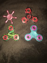three assorted color fidget spinners Upper Marlboro, 20772