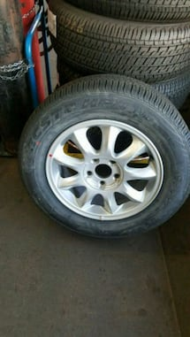 NEW 225/60/16 one tire only with the rim or without