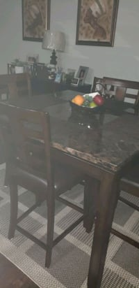 rectangular brown wooden table with six chairs din 49 km