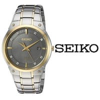round gold-colored analog watch with link bracelet Toronto, M6S 2T7