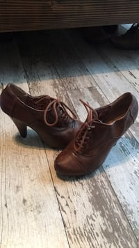 Pair of brown leather shoes 67 km