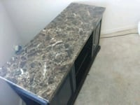 brown and black marble top table Marina