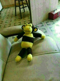 yellow and black monkey crochet doll
