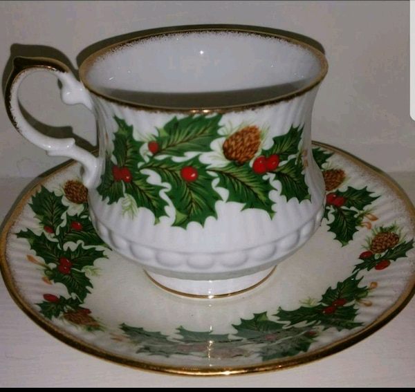 white-and-green floral ceramic teacup set