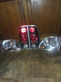 (PRICE DROPPED TO GO)..1998-03 Ford F-150 Headlight and Taillight set  New Eagle, 15067