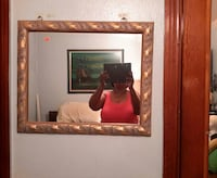 brown framed wall mirror