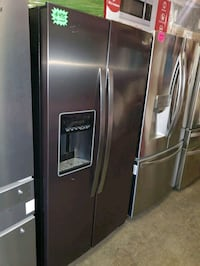 Whirlpool side by side Doors fridge in black stainless working perfect Baltimore, 21223