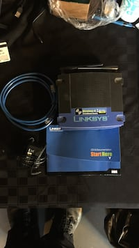 blue and black linksys router with box Perry, 19555