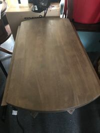 rectangular brown wooden table with chairs Santa Barbara, 93101