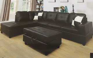 Black leather sectional couch and ottoman brand new