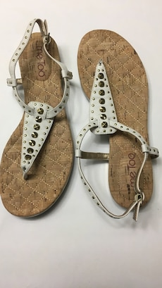 pair of gold and white sandals
