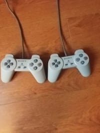 two white Sony PS3 controllers Mississauga, L5L