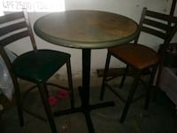 round brown wooden table with two chairs Cottage Grove, 97424