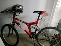 red and black full suspension mountain bike Victoria, V8T 1K3