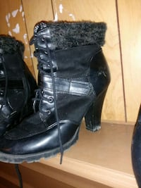 pair of black leather boots Panama City, 32405