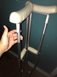 pair of gray-and-white axillary crutches