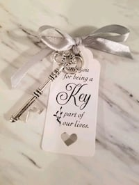 Bottle opener key favours with tag Barrie