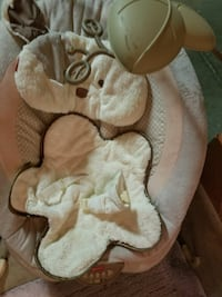baby's gray and white rocker bouncer
