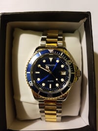 Gold tone luxury watch, blue dial. New York, 11432