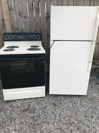Clean matching almond GE refrigerator and electric stove